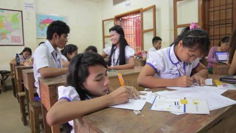 PHNOM PENH - JUNE 2012: students in NGO orphanage school Footage