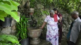 PHNOM PENH - JUNE 2012: indians wash hair with holy water Footage