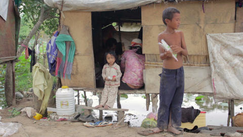 Boy in slum holding book Stock Video Footage