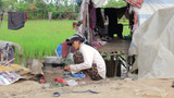 Mother Preparing Lunch In Slums stock footage