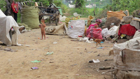 Naked kid and garbage gatherer Stock Video Footage