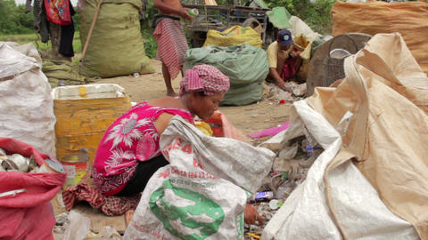 Garbage gatherers in slums Stock Video Footage
