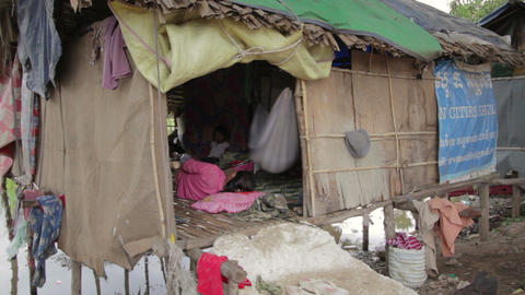 Mother cradle baby in slum Footage