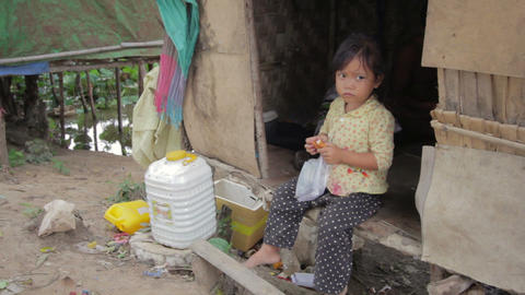 Cambodian kid eating in slums Stock Video Footage