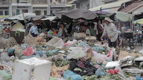 PHNOM PENH - JUNE 2012: local asian market dumping Stock Video Footage
