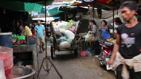 PHNOM PENH - JUNE 2012: local asian market dumping Stock Video Footage