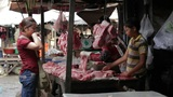 PHNOM PENH - JUNE 2012: local asian market butchers Footage