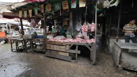 PHNOM PENH - JUNE 2012: local asian market butchers Stock Video Footage