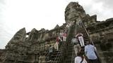 ANGKOR WAT - JUNE 2012: tourists climbing steps of angkor wat Footage