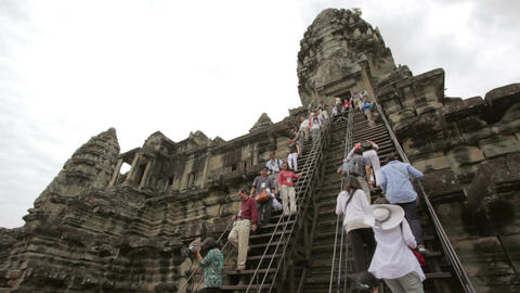 ANGKOR WAT - JUNE 2012: tourists climbing steps of angkor... Stock Video Footage