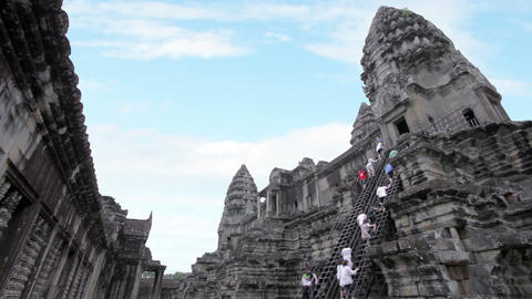 Tourists climbing angkor wat temple Footage