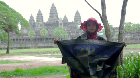 ANGKOR WAT - JUNE 2012: local seller shows her products Stock Video Footage