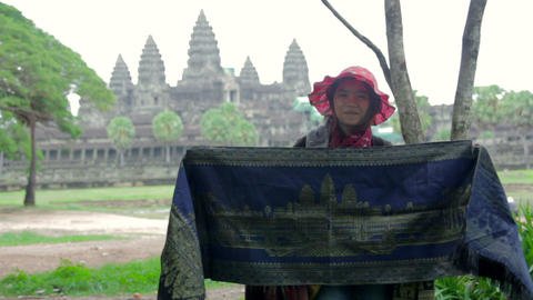 ANGKOR WAT - JUNE 2012: local seller shows her products Footage