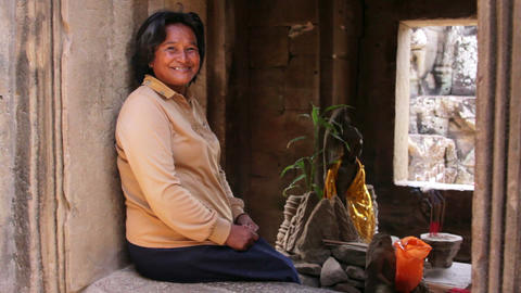ANGKOR WAT - JUNE 2012: local cambodian woman in temple Stock Video Footage