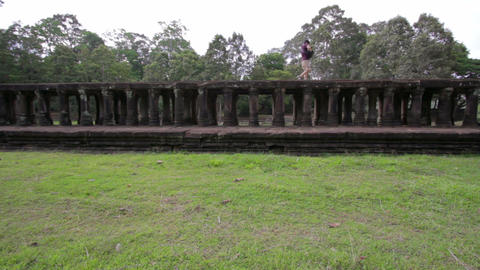 visitor walking on baphuon temple bridge Stock Video Footage