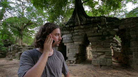 Talking with phone in jungle Stock Video Footage