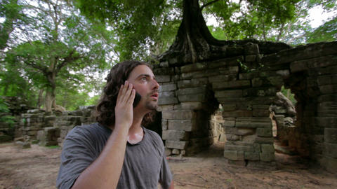 Talking with phone in jungle Footage