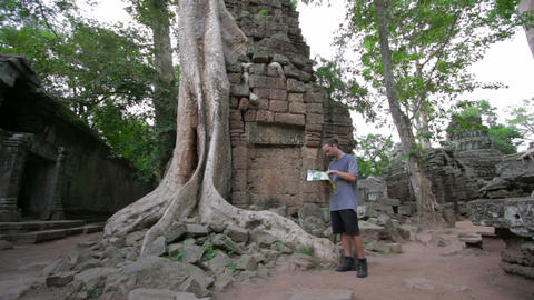Visitor reading tourist information Footage