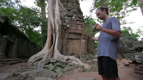 Visitor reading tourist information Stock Video Footage