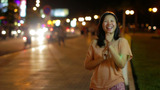 Happy Chinese Girl Outside At Night stock footage