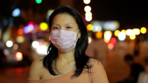 covering face with protection mask Stock Video Footage
