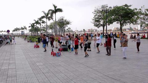 PHNOM PENH - JUNE 2012: outdoor tai chi in city center Stock Video Footage