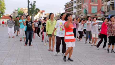 PHNOM PENH - JUNE 2012: outdoor tai chi in city center Stock Video Footage