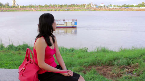 Happy chinese Young Woman by riverside Stock Video Footage