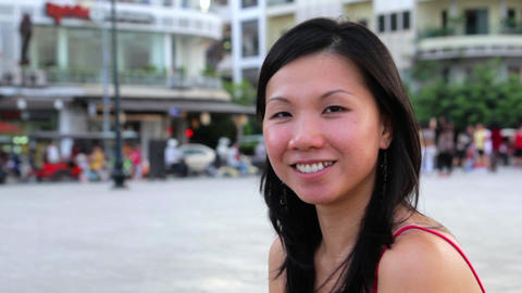 Happy chinese girl in city Stock Video Footage