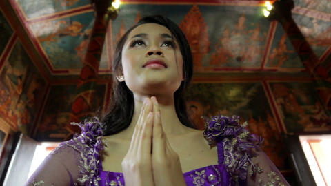 Asian girl praying in temple Footage