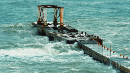 The old concrete structure in the sea breaking waves during a heavy storm Footage