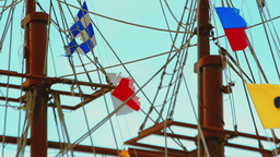 Masts and rigging of three-masted sailing ship over the bright blue sky. Close-u Footage