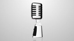 Loopable video 3840x2160 - Vintage silver microphone rotating on gray background Footage