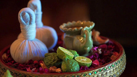 Video of Thai spa accessories setting with candles and herbs Footage