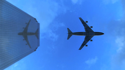 Video 4096x2304 4K - Down-top view of the airplane flies over the top of a skysc Footage