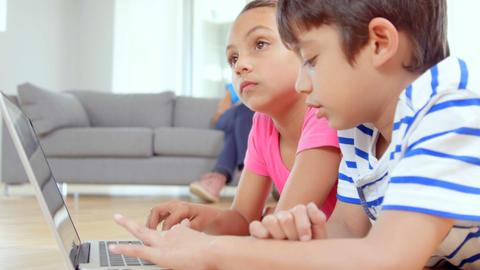 Focused children typing on laptop Footage