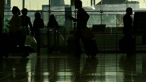 Silhouette of people walking on two layers and an anonymous lady walking away Footage