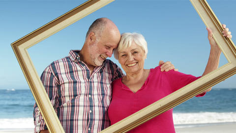 Senior couple holding frame Footage