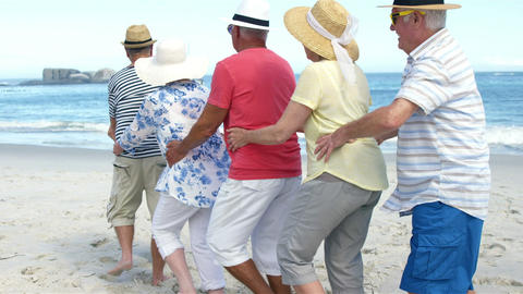 Senior friends dancing on the beach Footage