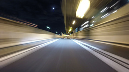 Motion timelapse through the bright city lights of central Tokyo Footage