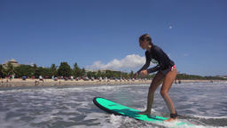 Girl surfing in the ocean Footage