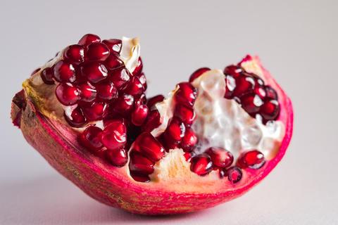 Ripe pomegranate fruit isolated on white background cutout フォト