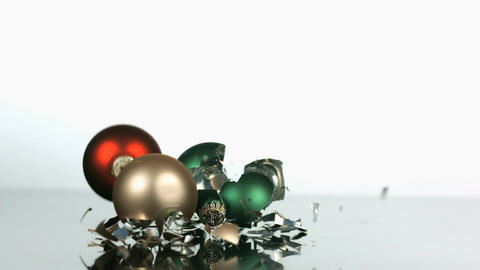 Slow motion dropping and smashing christmas ornaments Footage