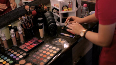 stylist artist work in her studio. make-up artist works with a cosmetic brush Footage