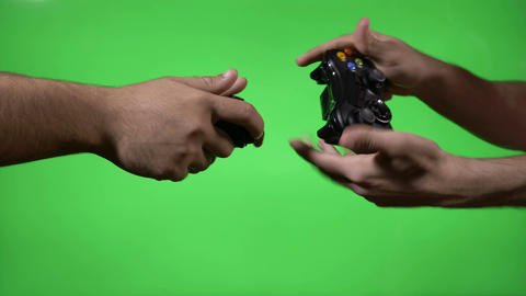 Hands of annoyed players using gamepads to outmatch each other in competition Footage