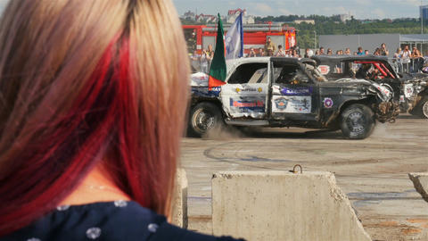 Smashed Old Autos Drive and Girl Head on Foreground Footage