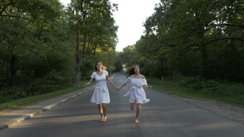 Young attractive women dressed in white running bare foot on a forest country Live影片