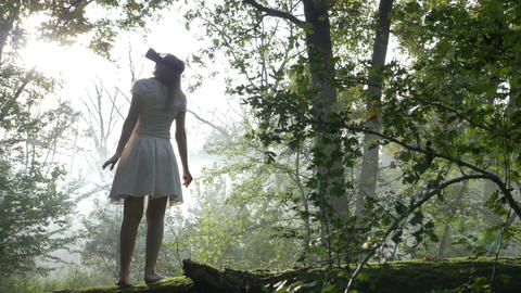 Young woman wearing virtual reality equipment and discovering a new world in the Footage