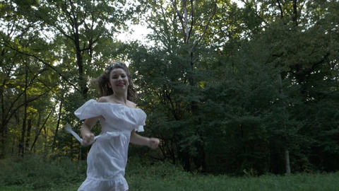 Freedom concept with girl laughing and running on a beautiful summer day in Footage