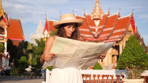 Beautiful Young Tourist Girl Exploring Map, Looking Around and Walking in Thai Footage